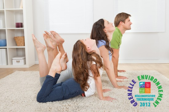 Full length of active family doing yoga on rug at home
